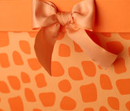 Gift with bow. Gift box with orange bow Stock Images