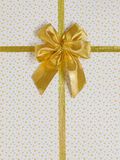 Gift bow with golden satin ribbon Royalty Free Stock Photo