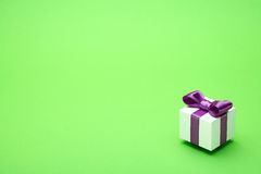 Gift with a bow on a green Stock Photography