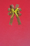 Gift bow on red background Royalty Free Stock Photography