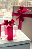 Gift with a bow. Transparent cube with a red ribbon Stock Images