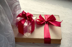 Gift with a bow. Transparent cube with a red ribbon Stock Photo