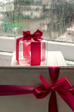 Gift with a bow. Transparent cube with a red ribbon Royalty Free Stock Photo