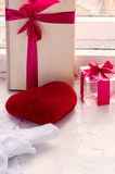 Gift with a bow. Transparent cube with a red ribbon Stock Photography