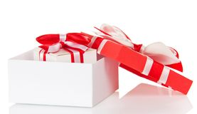 Gift with bow in white box and lid close Stock Image