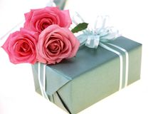 Gift Box. And red roses royalty free stock images