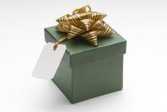 Gift box. Small green box with gift tag and ribbon Stock Image