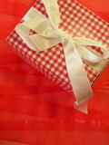 Gift box. With square isolated on red, white band Royalty Free Stock Photo