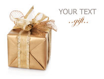 Gift box. Beautiful Golden Gift box with a big Bow isolated on white Royalty Free Stock Images
