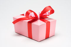 Gift box. Pink gift box with red ribbon Royalty Free Stock Photo