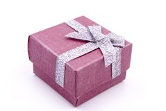 Gift Box. Red Gift Box with shiny silver ribbons Royalty Free Stock Photos