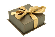 Gift box. With the golden ribbon. Isolated. White background Royalty Free Stock Photos