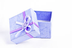 Gift box. A blue gift box opened on white background Stock Photos