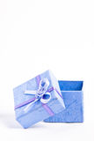 Gift box. A blue gift box opened on white background - vertical photo Royalty Free Stock Photography