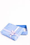 Gift box. A blue gift box opened on white background - vertical photo Stock Photo
