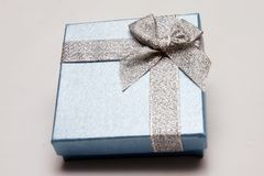 Gift Box. With Silver Ribbon against White background Stock Image