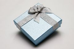 Gift Box. With Silver Ribbon against White background Stock Photo