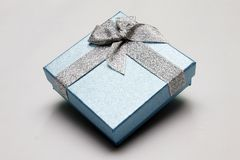 Gift Box. With Silver Ribbon against White background Royalty Free Stock Images