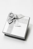 Gift Box. With Silver Ribbon against White background Stock Photos