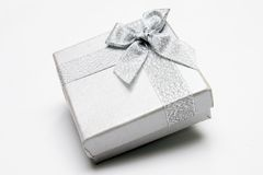 Gift Box. With Silver Ribbon against White background Royalty Free Stock Image