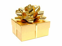 Gift box. Small golden gift box with bow and ribbon on a white background Stock Photography