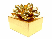 Gift box. Small golden gift box with bow isolated on white Stock Images