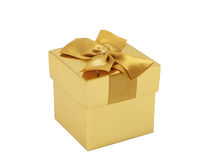 Gift box. Gold gift box with the golden ribbon. Isolated. White background Stock Photos