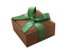 Gift box. Brown gift box with a green ribbon. Isolated. White background Stock Photography
