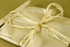 Gift box. On a golden background Stock Image