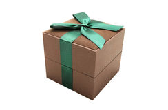 Gift box. Brown gift box with a green ribbon. Isolated. White background Royalty Free Stock Photography
