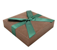 Gift box. Brown gift box with a green ribbon. Isolated. White background Royalty Free Stock Photos