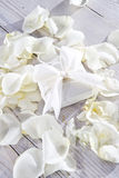 Gift box. Gift package for anniversary and rose petals royalty free stock photo