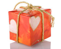 Gift box. Tied with a gold cord Royalty Free Stock Images