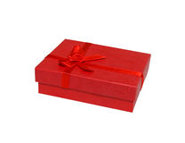 Gift box. Red gift box with a red ribbon. Isolated. White background Royalty Free Stock Images