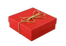 Gift box. Red gift box with a gold ribbon. Isolated. White background royalty free stock images
