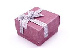 Gift Box. Red Gift Box with shiny silver ribbons Stock Image