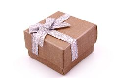 Gift Box. Orange Gift Box with shiny silver ribbons Stock Images