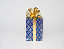 Gift box. The parents give gift box for the childen in Royalty Free Stock Image