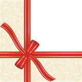 Gift box. Red gift ribbon wrapped around decorative background with copy space Royalty Free Stock Photos