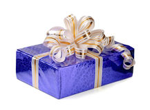 Gift box. Shiny gift box with ribbon isolated on white royalty free stock photography