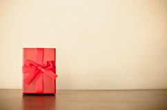Gift box. Red gift box on the floor Stock Images