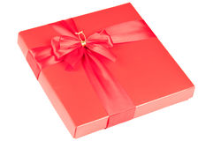 Gift box. Red gift box with bow over a white background Royalty Free Stock Image