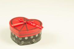 Gift box. Gift box and red heart-shaped black box royalty free stock image