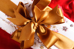 Gift Box. With a golden ribbon and bow Stock Photo