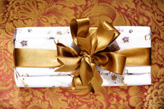 Gift Box. With a golden ribbon and bow Stock Image