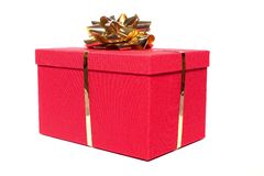 Gift box. Red gift box with a gold bow on white Royalty Free Stock Photos