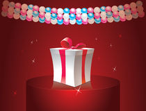 Gift box. With garland on red background Stock Images