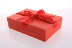 Gift box. Red color gift box with beautiful ribbon Royalty Free Stock Photo