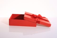 Gift box. Red color gift box with beautiful ribbon Stock Photography