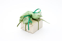 Gift box. Elegant present wrapped with green ribbons Stock Image